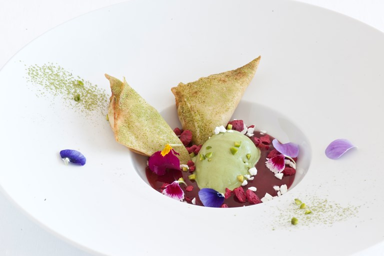 Sfogliatelle samosas with green tea ice cream and berry sauce