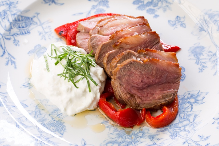 Saddle of lamb with burrata and marinated Romano peppers