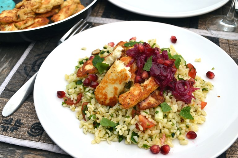 Marinated halloumi with a mint, pomegranate and red onion relish and bulgur wheat salad