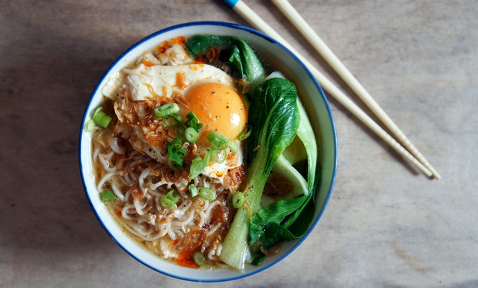 Miso ramen soup with pak choi, poached egg, and crispy shallots