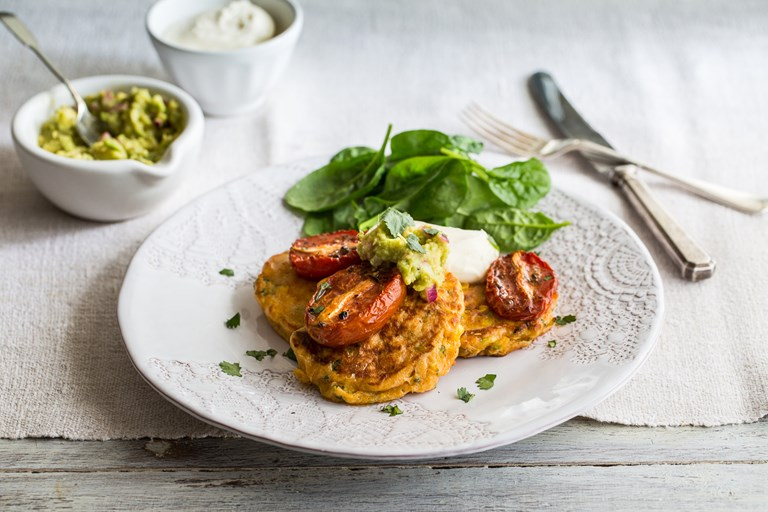 Sweetcorn fritters with slow roasted tomatoes and smashed avocado