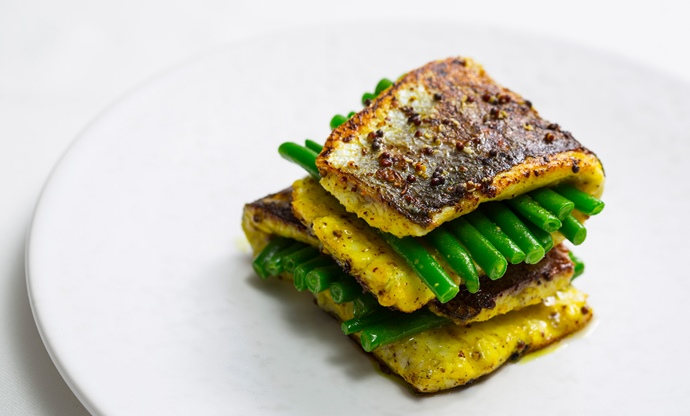 Sea bass marinated in mustard seed, turmeric and vinegar