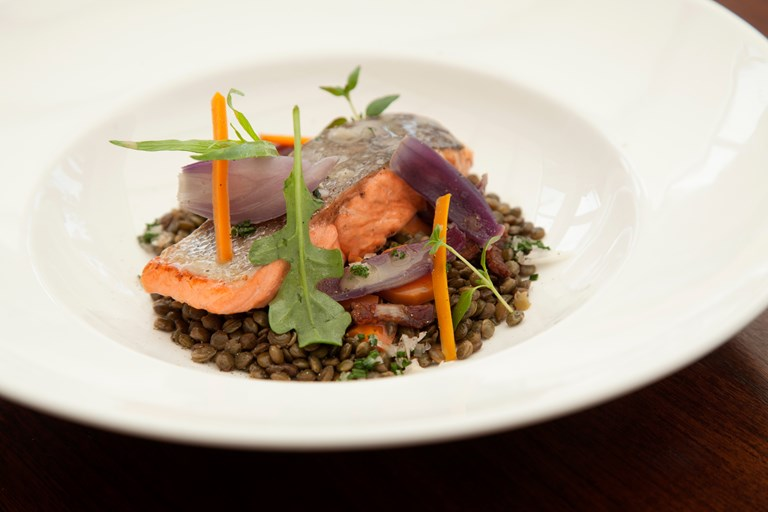 Pan-roasted fjord trout with lentils, crispy bacon and rocket leaves