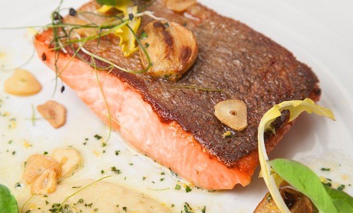 Pan-fried fjord trout with white bean purée and garlic crisps