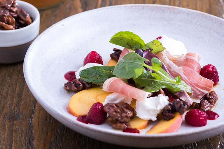Pickled walnuts, goat's curd, smoked Kelmscott cured ham, peach and raspberry salad