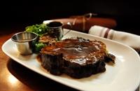 Rib-eye steak with roasted garlic, grilled lemon, horseradish cream and chimichurri