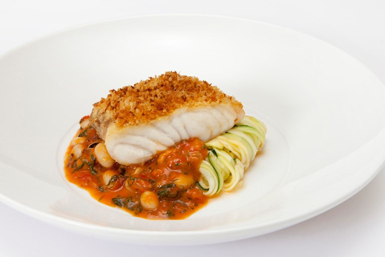 Hake with courgettes, Provençal mussel sauce and crispy breadcrumbs