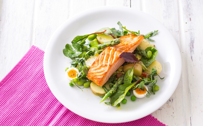 Slow-baked salmon with new potatoes, quail eggs, baby salad, avocado and a tomato salsa