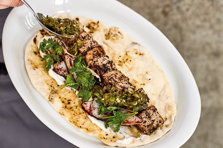 Veal shish and onion salad flatbread with charred sivri biber relish