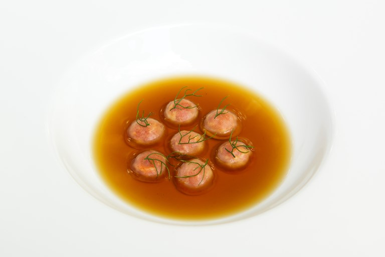 Almond and 'Nduja buttons with potato broth