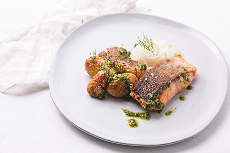 Sous vide salmon with pickled kohlrabi, garden pesto and new potatoes