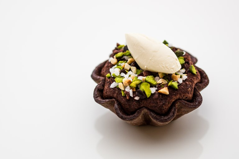 Chocolate fondant tartlet, cocoa nibs and hazelnut praline