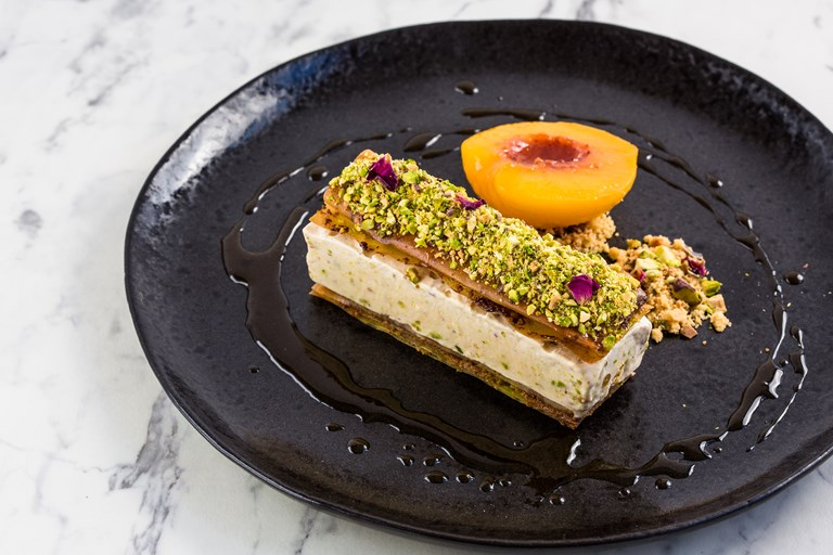 Middle Eastern 'ice cream sandwich' with poached peaches
