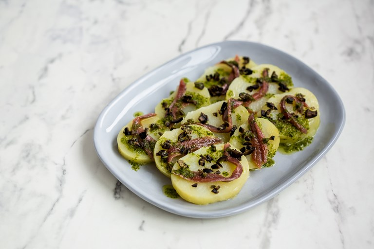 Potato dischetti with anchovy and capers