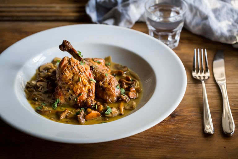Guinea fowl with wild mushrooms