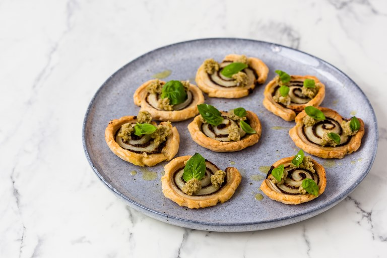 Wild mushroom palmiers with green olive and truffle tapenade