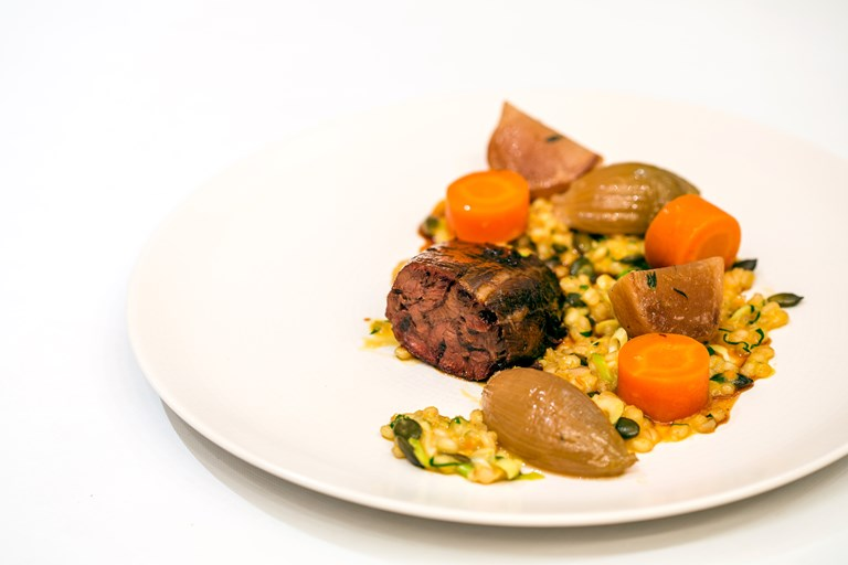 Braised beef shin with pumpkin seed and barley risotto