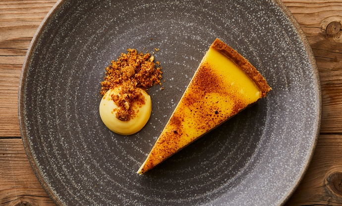 Passion fruit tart, lemon curd sauce and hazelnut praline
