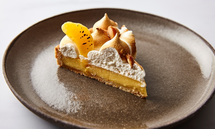 Clementine tart with Italian meringue and caramelised macadamias