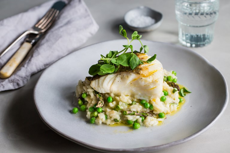 Pan-roasted cod with asparagus and pea risotto