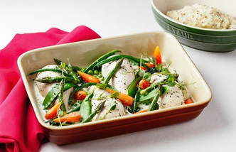Poached chicken breast with summer vegetables, wholegrain mustard mash and tarragon sauce