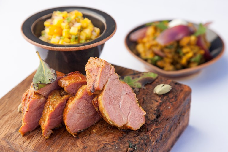 Sous vide lamb neck fillet with mango salsa and dhal