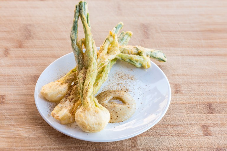 Tempura spring onions with onion purée