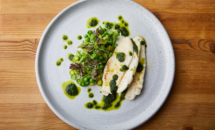 Butter-steamed lemon sole, English garden pesto, asparagus and pea salad