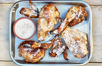 Barbecued chicken with Alabama white sauce