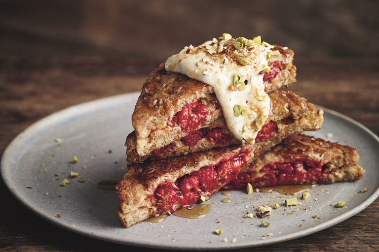 Almond butter and smashed raspberry stuffed French toast