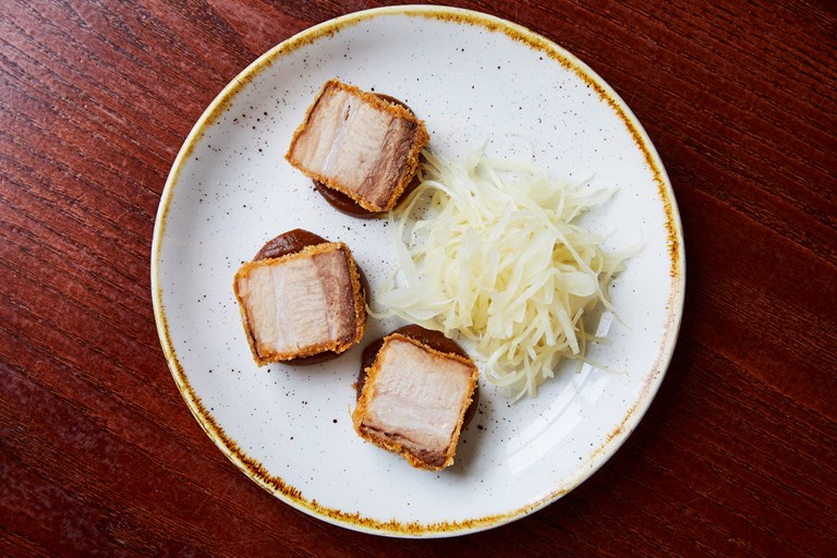 Crispy pork belly with brown sauce