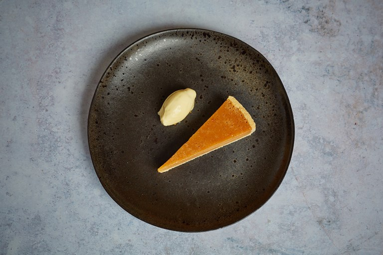 Salted caramel tart with banana and passionfruit sorbet