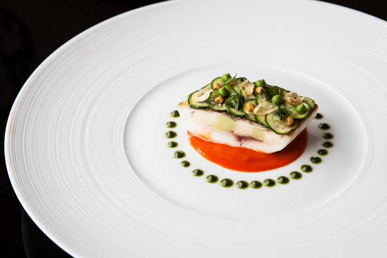 Fillet of sea bream stuffed with scallop mousse, piquillo pepper and pine nuts