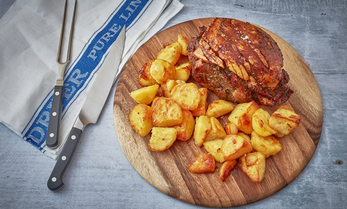 Lemon and fennel slow cooked pork shoulder with roast potatoes