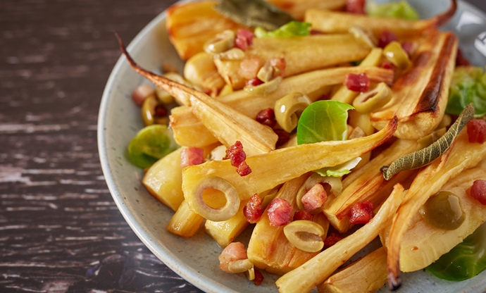 Roast parsnips with bacon, olives and sprout leaves