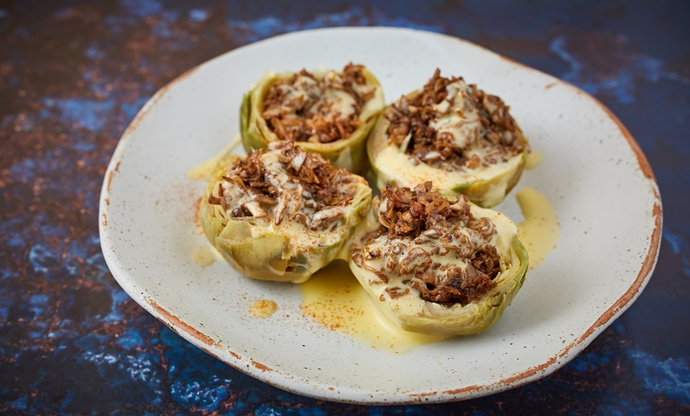 Warm artichoke heart with mushroom stuffing and Hollandaise sauce
