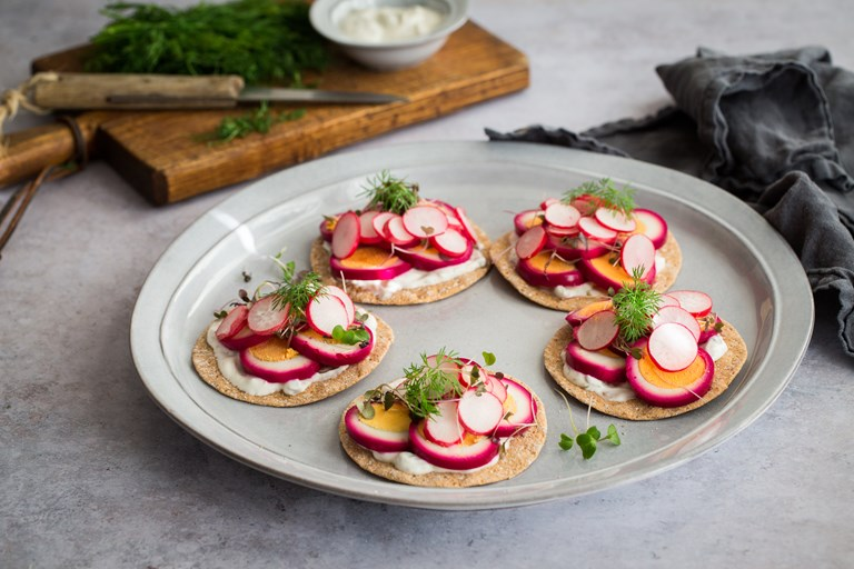 Sourdough crispbreads with beetroot pickled eggs and dill and caper yoghurt