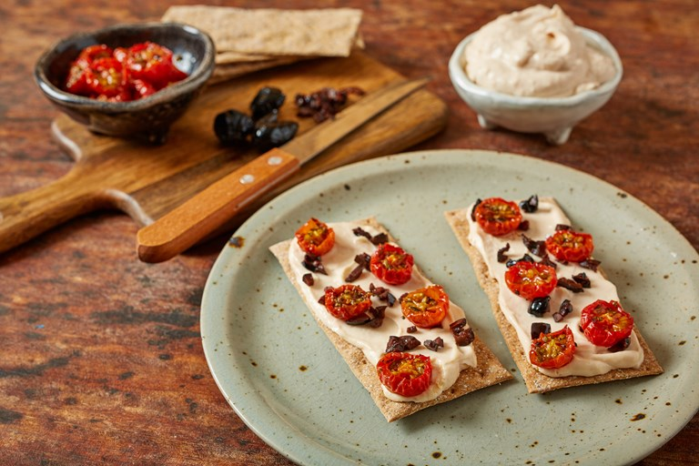 Homemade taramasalata, tomato and black olive crispbreads