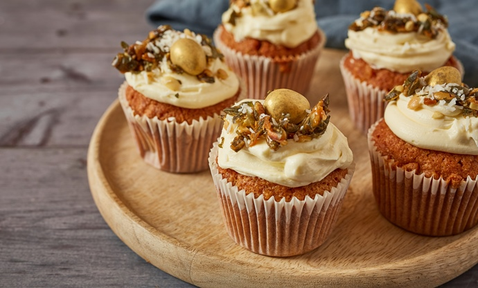 Spiced spelt and carrot cupcakes with white chocolate buttercream and pumpkin seed brittle