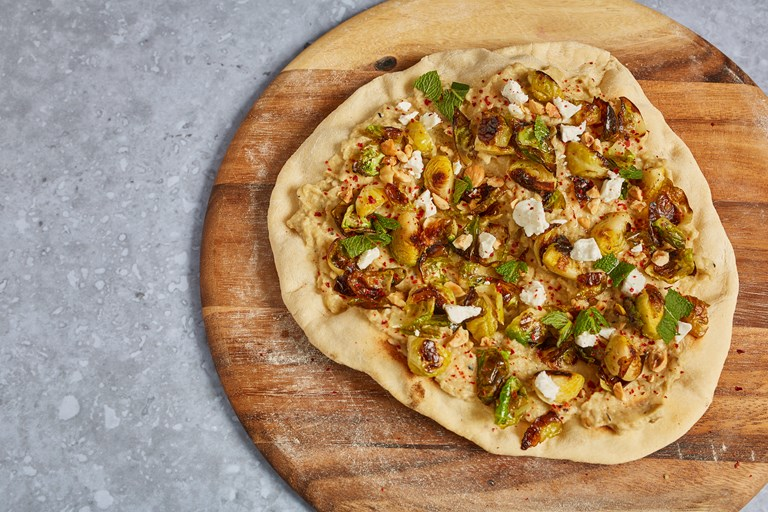 Baba ganoush and Brussels sprouts flatbread with feta, hazelnuts and mint