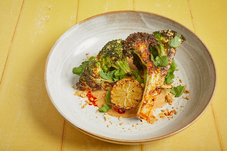 Barbecued broccoli with satay sauce, charred lime, toasted peanut, coriander
