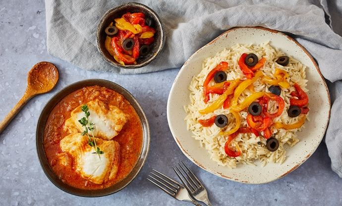 Fish yassa with butter rice, olives and roasted sweet peppers