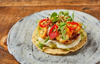 Clam and kumquat tostada with peanut salsa macha