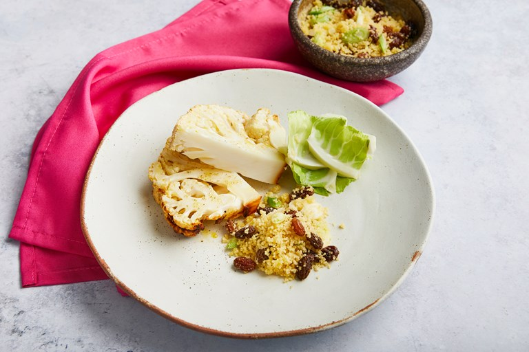 Spiced whole roast cauliflower with couscous and raisins