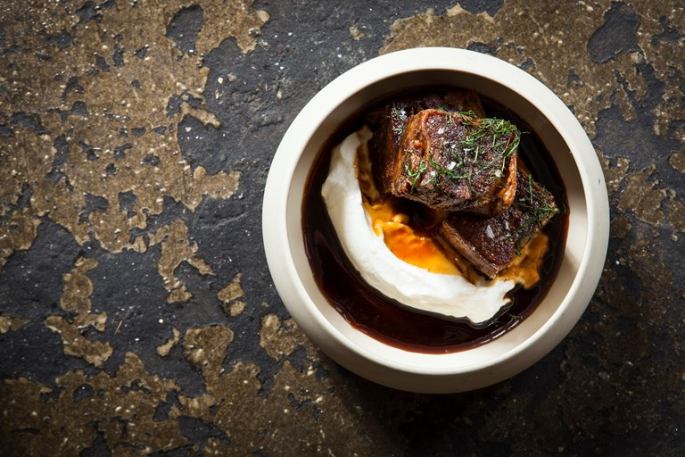 Crispy pomegranate-glazed lamb breast with yoghurt