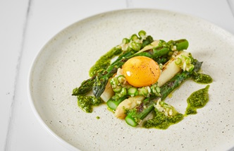 Charred white and green asparagus with pickled egg yolk and pesto