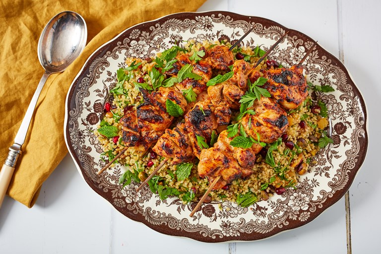 Yoghurt-marinated grilled chicken skewers with jewelled bulgur wheat salad