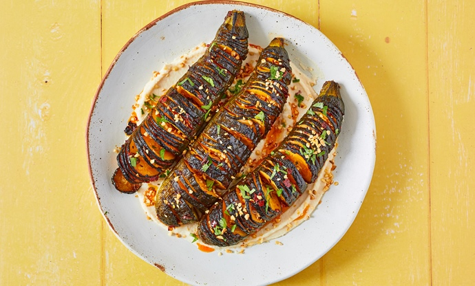 Harissa hasselback courgettes with butterbean and tahini dip and dukkah