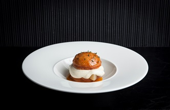 Brioche doughnut with poached peaches and meadowsweet crème diplomat