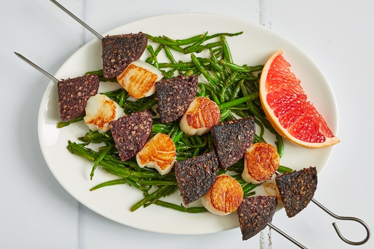 Black pudding and scallop skewers with samphire and pink grapefruit